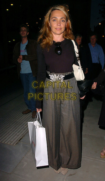 JEANNE MARINE.At The Roundhouse Re-Opening & Gala Night,.London, England, June 5th 2006..full length goody bag grey baggy wide leg pinstripe trousers belt black top.Ref: CAN.www.capitalpictures.com.sales@capitalpictures.com.©Can Nguyen/Capital Pictures