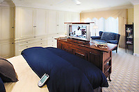 Master Bedroom With Couch And Pop Up TV