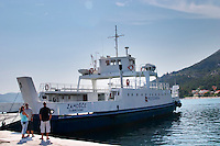The car and passenger ferry between Orebic and Korcula in the Orebic harbour. Two men standing on the key. Orebic town, holiday resort on the south coast of the Peljesac peninsula. Orebic town. Peljesac peninsula. Dalmatian Coast, Croatia, Europe.
