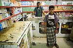 Shop owner and son in their grocery store, Hawf Protected Area, Yemen
