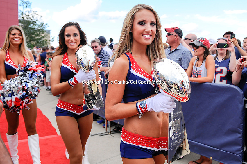 August 5, 2015: New England Patriots cheerleaders carry the team's Lombardi trophies during the 2015 Patriots Hall of Fame induction held in front of The Hall at Patriot Place at Gillette Stadium in Foxborough, Massachusetts. Eric Canha/CSM
