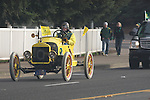 A Duck fan drives down Martin Luther King Boulevard towards Autzen Stadium in his antique car..Photo by Jaime Valdez..