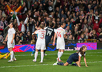 Manchester, England - Monday, August 6, 2012: The USA defeated Canada 4-3 in overtime in the semi-final round of the 2012 London Olympics at Old Trafford. Alex Morgan celebrates after she heads the ball in for a goal.