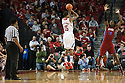 November 17, 2013: Ray Gallegos (15) of the Nebraska Cornhuskers makes a three pointer against Darryl Palmer (30) of the South Carolina State Bulldogs at the Pinnacle Bank Areana, Lincoln, NE. Nebraska defeated South Carolina State 83 to 57.