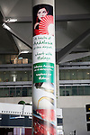 Tourist advertising poster on a building column at Malaga airport, Spain