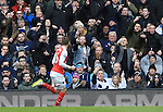 Arsenal's Aaron Ramsey celebrates scoring his sides opening goal as Tottenham's fans tell him exactly what they think<br /> - English Premier League - Tottenham Hotspur vs Arsenal  - White Hart Lane - London - England - 5th March 2016 - Pic David Klein/Sportimage