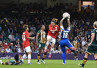 July 31, 2012..Japan's Karina Maruyama (13) tries to score with a header as South Africa's Thokozile Mndaweni (18) saves during Group F Women's Football match between JPN and RSA at the Millennium Stadium on day four of 2012 Olympic Games in Cardiff, United Kingdom...