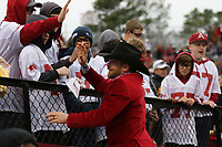 Arkansas Democrat-Gazette/THOMAS METTHE -- 11/29/2019 --<br /> Chase Outlaw, a professional bull rider from Hamburg, high-fives fans during the third quarter of the Razorbacks' 24-14 loss to Missouri on Friday, Nov. 29, 2019, at War Memorial Stadium in Little Rock.