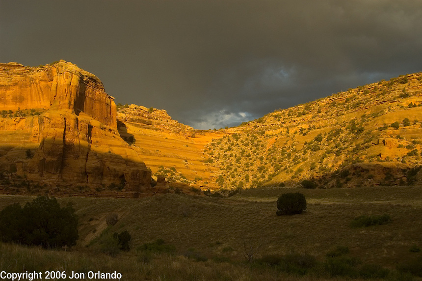 The sun sets on the sandstone walls of Horsethief  Canyon on the Colorado River in western Colorado.