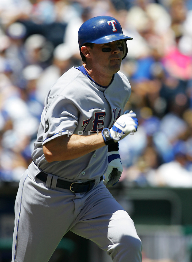 Michael Young, of the Texas Rangers , in action against the Kansas City Royals on June 5, 2005...Rangers win 8-1...Dilip Vishwanat / SportPics