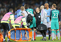 Tottenham Hotspur's Moussa Sissoko leaves the field injured while receiving a yellow card from referee Cuneyt Cakır<br /> <br /> Photographer Rich Linley/CameraSport<br /> <br /> UEFA Champions League - Quarter-finals 2nd Leg - Manchester City v Tottenham Hotspur - Wednesday April 17th 2019 - The Etihad - Manchester<br />  <br /> World Copyright © 2018 CameraSport. All rights reserved. 43 Linden Ave. Countesthorpe. Leicester. England. LE8 5PG - Tel: +44 (0) 116 277 4147 - admin@camerasport.com - www.camerasport.com