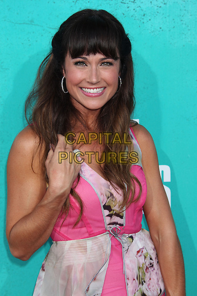 Nikki Deloach.2012 MTV Movie Awards held at the Gibson Amphitheatre, Universal City, California, UA..June 3rd, 2012.half length pink white print dress hand arm.CAP/ADM/RE.©Russ Elliot/AdMedia/Capital Pictures.