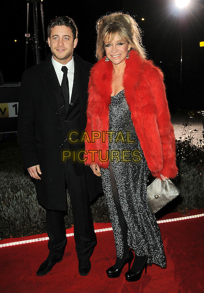 TYRONE WOOD & JO WOOD .A Night Of Heroes: The Sun Military Awards, Imperial War Museum, Lambeth Road, London, England, .15th December  2010..full length red fur coat ty son mom mum mother family suit black tie gold clutch bag .CAP/CAS.©Bob Cass/Capital Pictures.