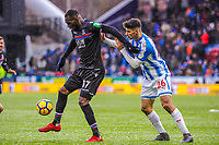 Crystal Palace's forward Christian Benteke (17) holds off Huddersfield Town's defender Christopher Schindler (26) during the EPL - Premier League match between Huddersfield Town and Crystal Palace at the John Smith's Stadium, Huddersfield, England on 17 March 2018. Photo by Stephen Buckley / PRiME Media Images.