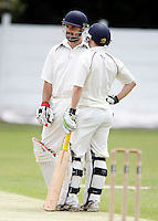 North Middlesex captain Alex Hill (L) in discussion with Adam Holmes during the Middlesex County League Division two game between North Middlesex and Hornsey at Park Road, Crouch End on Sat July 9, 2011