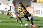 Brisbane Roar's Daniel Bowles, left, pulls the shirt of Phoenix's Tyler Boyd, right, as he chases the ball in the A-League football match at Westpac Stadium, Wellington, New Zealand, Sunday, January 04, 2015. Credit: Dean Pemberton