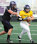 SIOUX FALLS, SD - APRIL 28: Eric Anderson #45 of the University of Sioux Falls sacks quarterback Taylor Perkins during the Cougars spring scrimmage Saturday evening at Bob Young Field. (Photo by Dave Eggen/Inertia)