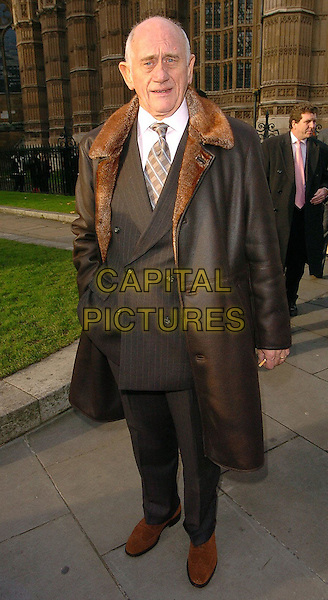 JOHN BARDON.Woman's Own Children of Courage Awards Departures, London..UK, United Kingdom.14th December 2005.Ref: CAN.full length brown sheepskin leather long winter coat fur lining collar brogues shoes cigarette hand in pocket.www.capitalpictures.com.sales@capitalpictures.com.©Capital Pictures