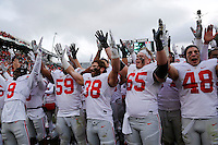 Ohio State Buckeyes players sing Carmen Ohio following the Buckeyes' 17-16 win over the Michigan State Spartans in the NCAA football game at Spartan Stadium in East Lansing, Mich. on Nov. 19, 2016. (Adam Cairns / The Columbus Dispatch)