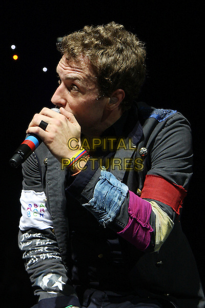 COLDPLAY - CHRIS MARTIN.Live at the 02 Arena, London, England..December 14th, 2008.stage concert gig performance music half length black jacket singing .CAP/MAR.© Martin Harris/Capital Pictures.