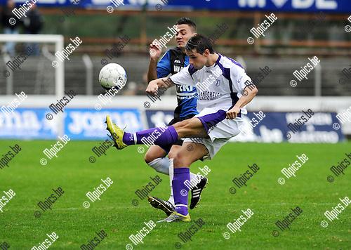 2011-10-09 / Voetbal / seizoen 2011-2012 / Rupel-Boom - Patro Eisden / Battista (Patro) met Pellegriti achter zich..Foto: Mpics