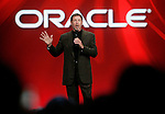 FILE - In this Sept. 24, 2008 file photo, Oracle CEO Larry Ellison gestures at the Oracle Open World conference in San Francisco. Oracle Corp. on Monday, April 20, 2009 snapped up computer server and software maker Sun Microsystems Inc. for $7.4 billion, pouncing on an opportunity that opened up after rival IBM Corp. abandoned an earlier bid to buy one of Silicon Valley's best known, and most troubled companies. (AP Photo/Paul Sakuma, file)