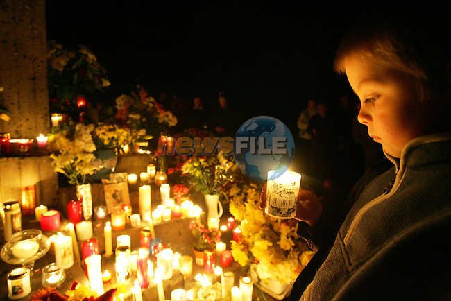 Drogheda Ireland, Seven year old Mark Hoey prayes while holding a lighted candle at The Papal Cross at Kilaneer where 26 years ago Pope John Paul II spoke to Catholics from North and Southof the Boarder with a message of peace during his visit to Ireland, Today thousands of catholics laid flowers and candles in remberence of the pope. The head of Ireland's Roman Catholic Church hailed Pope John Paul II Sunday as a man in advance of his time, saying his 26-year papacy would |eave an 'immense' legacy for the world. Pope John Paul II died 03 April at the age of 85..Photo AFP/NEWSFILE/FRAN CAFFREY..(Photo credit should read AFP Photo FRAN CAFFREY/NEWSFILE)...This Picture has been sent you under the condtions enclosed by:.Newsfile Ltd..the Studio,.Millmount Abbey,.Drogheda,.Co Meath..Ireland..Tel: +353(0)41-9871240.Fax: +353(0)41-9871260.GSM: +353(0)86-2500958.email: pictures@newsfile.ie.www.newsfile.ie.FTP: 193.120.102.198..This picture is from Fran Caffrey@newsfile.ie