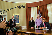 United States President Barack Obama signs an Executive Order directing the Food and Drug Administration to take action to help prevent and reduce prescription drug shortages and protect consumers and from price gouging in the Oval Office of the White House on Monday, October 31, 2011. The President was joined by Bonnie Frawley, Secretary of Health and Human Services Kathleen Sebelius, Jay Cuetara and FDA Commissioner Peggy Hamburg. .Credit: Kristoffer Tripplaar  / Pool via CNP
