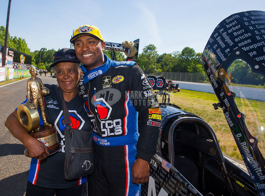 Jun 7, 2015; Englishtown, NJ, USA; NHRA top fuel driver Antron Brown (right) celebrates with his grandmother after winning the Summernationals at Old Bridge Township Raceway Park. Mandatory Credit: Mark J. Rebilas-
