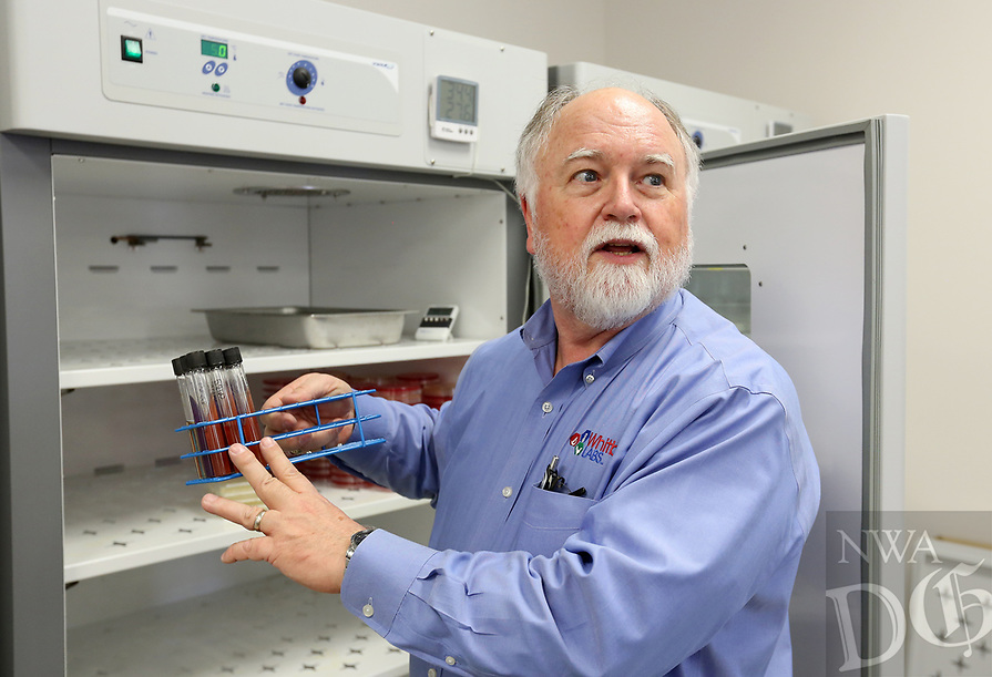 NWA Democrat-Gazette/DAVID GOTTSCHALK Gordon Whitbeck, president, describes salmonella testing in front of incubators at Whitbeck Laboratories in Springdale. The business is located on a corner lot of the industrial park in the city.