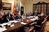 Washington, DC - June 9, 2009 -- United States President Barack Obama drops by a Green Cabinet meeting in the Roosevelt Room of the White House to discuss the importance of passing comprehensive energy legislation, June 9, 2009. .Mandatory Credit: Pete Souza - White House via CNP