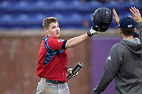 Matthew Cocciadiferro (8) of the NJIT Highlanders is congratulated by his teammates after scoring a run during game two of a double-header against the High Point Panthers at Williard Stadium on February 18, 2017 in High Point, North Carolina.  The Highlanders defeated the Panthers 4-2.  (Brian Westerholt/Four Seam Images)