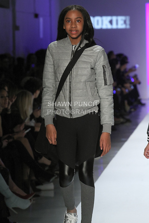 new concept e109e f9287 Model walks runway in an outfit from the Converse kids Fall 2017  collection, during the