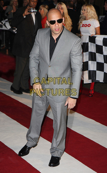 "VIN DIESEL.""Fast & Furious"" UK film premiere at VUE west End cinema, Leicester Square, London, England 19th March 2009.full length grey gray suit black sunglasses shoes shirt .CAP/MAR.©Martin Harris/Capital Pictures"