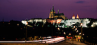 Distant view of Prague Castle and the Manesuv Bridge at night. Prague, Czech Republic.