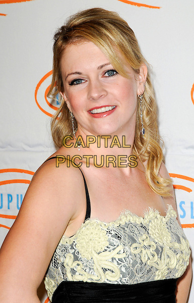 MELISSA JOAN HART.Lupus LA's 7th Annual Bag Ladies Luncheon to raise funds for lupus research at the Beverly Wilshire Four Seasons Hotel in Beverly Hills, California, USA..November 18th, 2009.headshot portrait pale yellow lace cream black smiling hair up dangly earrings .CAP/ROT.©Lee Roth/Capital Pictures