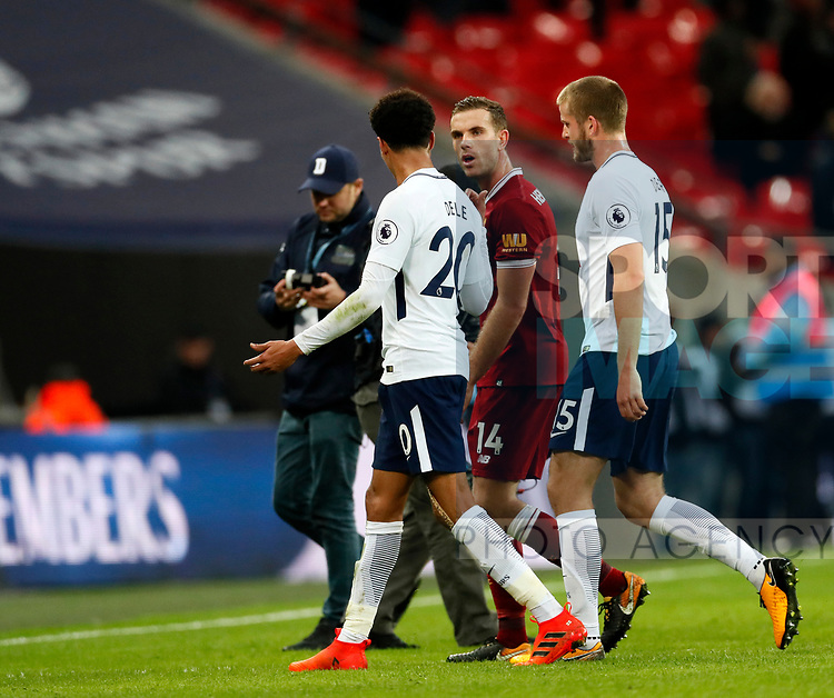 Tottenham's Dele Alli and Liverpool's Jordan Henderson argue at the final whistle during the premier league match at Wembley Stadium, London. Picture date 22nd October 2017. Picture credit should read: David Klein/Sportimage