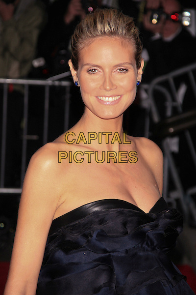 "HEIDI KLUM .Arrivals for the Met Costume Institute Gala Benefit - ""The Model as Muse: Embodying Fashion"" at the Metropolitan Museum of Art, New York, NY, USA, .May 4th 2009..portrait headshot hair up earrings sapphire studs strapless blue black pregnant .CAP/LNC/TOM.©LNC/Capital Pictures"