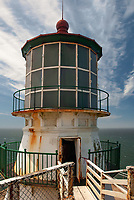 Point Reyes Lighthouse's light tower is separted from the house and sits on a shoreline rock outcropping, Marin County, California