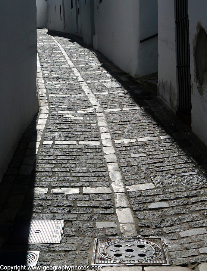Narrow cobbled alleyway street in Vejer de la Frontera, Cadiz Province, Spain