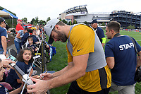 July 26, 2018: New England Patriots wide receiver Julian Edelman (11) signs an autograph for a fan at the New England Patriots training camp held on the practice fields at Gillette Stadium, in Foxborough, Massachusetts. Eric Canha/CSM