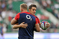 Calum Clark with team-mate George Kruis of England during the pre-match warm-up. QBE International match between England and France on August 15, 2015 at Twickenham Stadium in London, England. Photo by: Patrick Khachfe / Onside Images