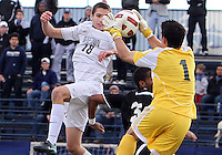 Steve Neumann #18 of Georgetown University heads the ball to Jhojan Obando #1 of Providence University during a Big East quarter-final  match at North Kehoe Field, Georgetown University on November 6 2010 in Washington D.C. Providence won 2-1.