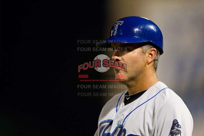 Batting Coach Dave Hajek (3) of the Tulsa Drillers stands on the first base line during a game against the Springfield Cardinals at Hammons Field on July 18, 2011 in Springfield, Missouri. Tulsa defeated Springfield 13-8. (David Welker / Four Seam Images)