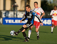 Chris Leitch of Earthquakes kicks the ball away from Seth Stammler of Red Bull during the game at Buck Shaw Stadium in Santa Clara, California.  San Jose Earthquakes defeated New York Red Bulls, 4-0.