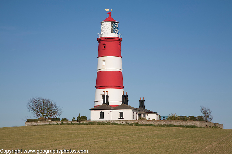 Red and white stripes of Happisburgh lighthouse, Norfolk, England