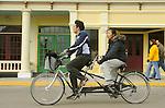 Market street Mackinac Island. Husband and wife cycling.