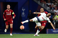 Tottenham Hotspur's Lucas Moura, foreground, is challenged by Liverpool's Fabinho during the UEFA Champions League final football match between Tottenham Hotspur and Liverpool at Madrid's Wanda Metropolitano Stadium, Spain, June 1, 2019.<br /> UPDATE IMAGES PRESS/Isabella Bonotto