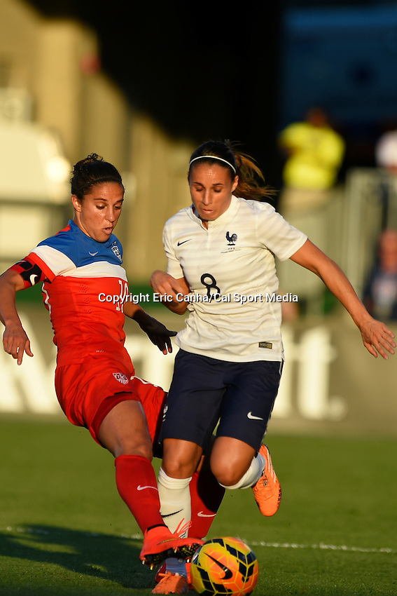 June 19, 2014 - East Hartford, Conn. U.S. - United State's Carli Lloyd (10) steals the ball from France's Jessica Houara (8) during the USA Women's Soccer friendly game between USA and France held at Rentschler Field in East Hartford Connecticut. The match ended with a 2-2 tied score. Eric Canha/CSM