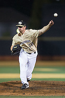 Wake Forest Demon Deacons relief pitcher Carter Bach (18) delivers a pitch to the plate against the Davidson Wildcats at David F. Couch Ballpark on February 28, 2017 in Winston-Salem, North Carolina.  The Demon Deacons defeated the Wildcats 13-5.  (Brian Westerholt/Four Seam Images)